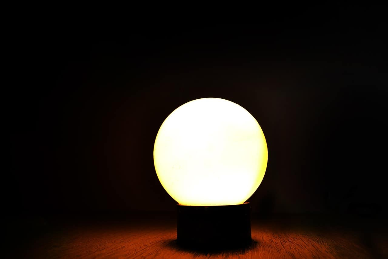 A lamp that is sitting in the dark