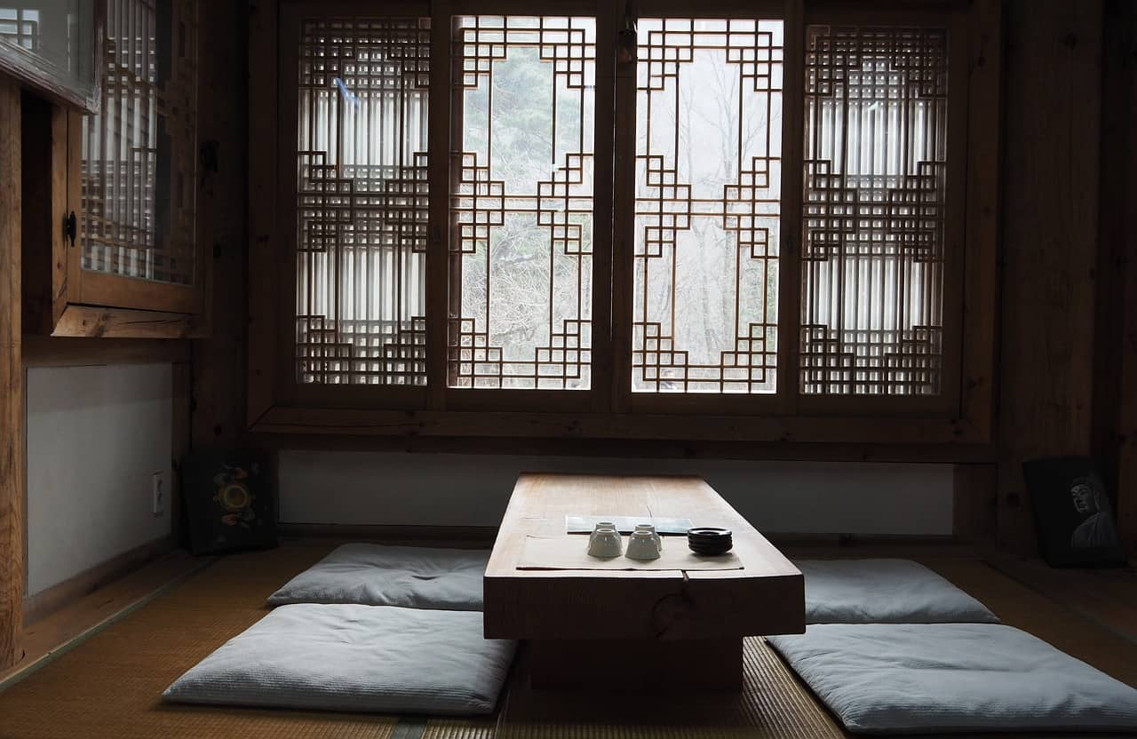 A bedroom with a bed and a large window
